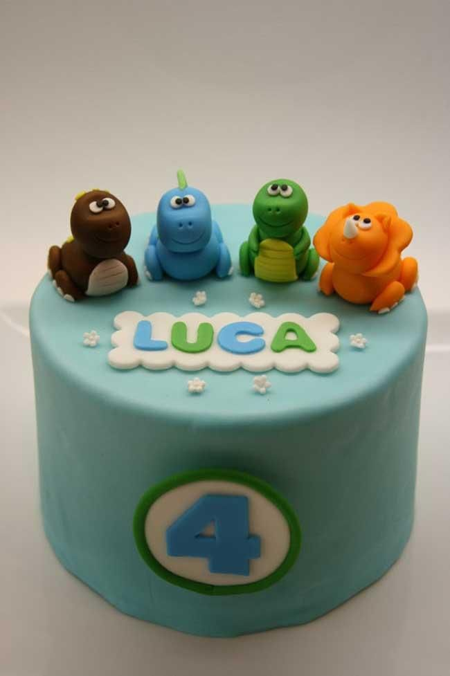 Adorable fondant baby dinosaurs top this pale blue cake.