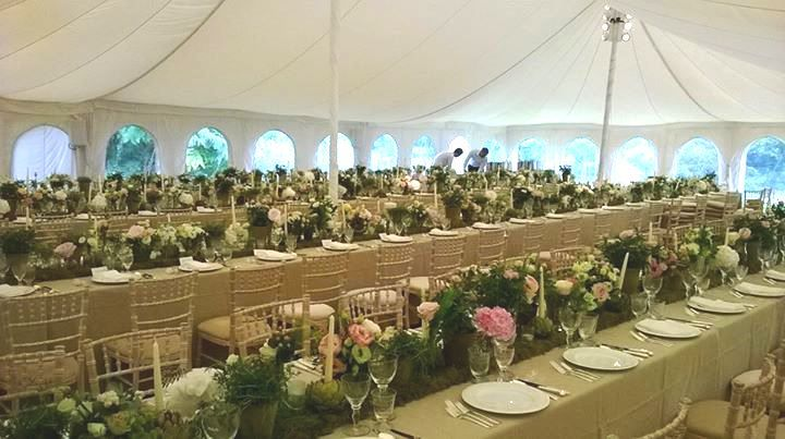 Table runners made from moss with beautiful garden flowers and lots of candles  - for a wedding at the Garden in September 2015. Flowers by http://www.fabulousflowers.biz/