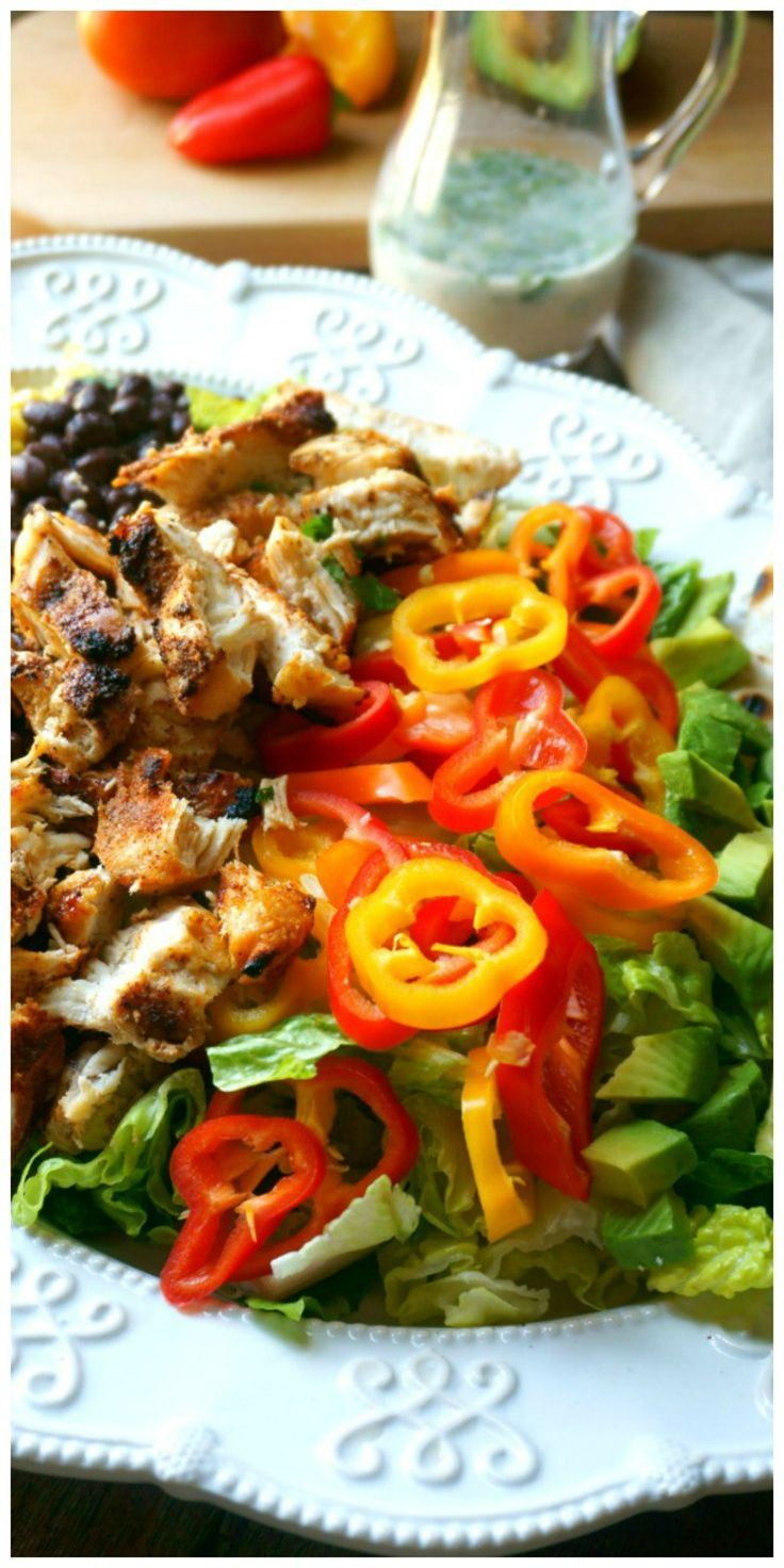 A southwestern spin on a classic cobb salad - crisp romaine is topped with corn, avocado, tomatoes, peppers, grilled chicken. Served with cheese quesadillas in place of croutons and completed with a Cilantro Lime Dressing.
