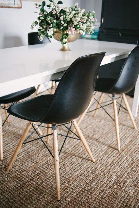 black Eames chairs in dining room