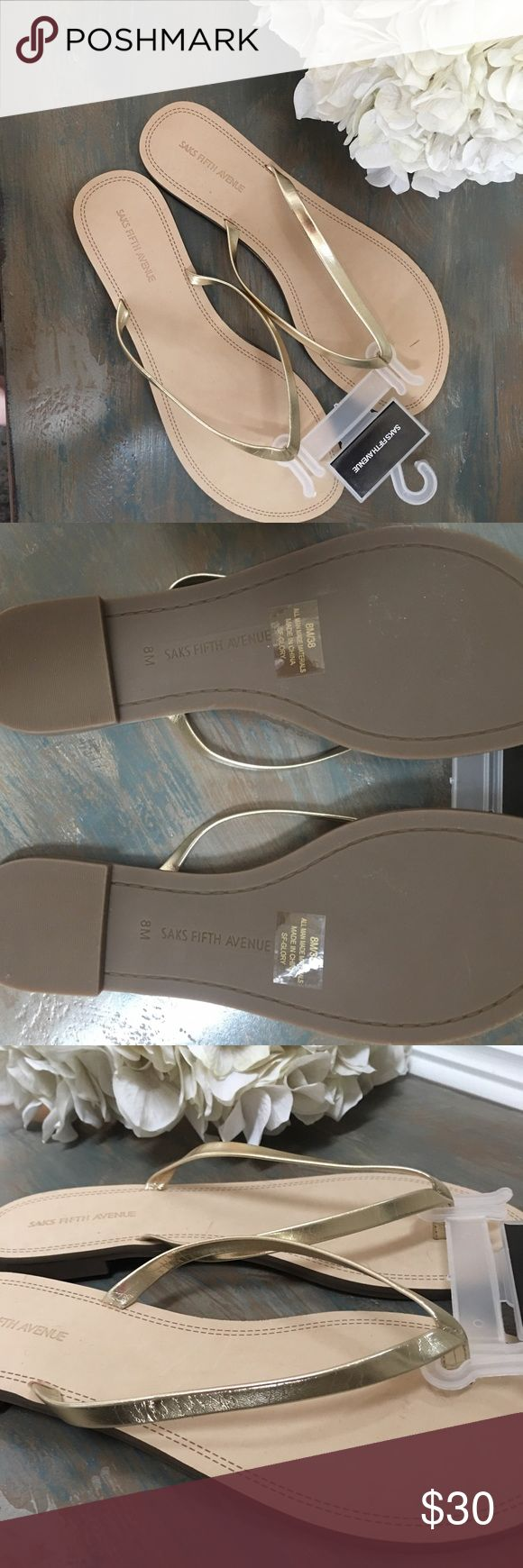 Gold flip flops/sandals Brand new with tags!  Gold flip flops from Saks fifth avenue.  Adorable! Size 8. Saks Fifth Avenue Shoes Sandals