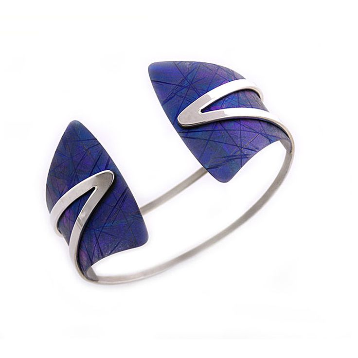 Blue titanium B208 bracelet by Jean Yves Nantel. Anodized titanium is accented with sterling silver in this modern cuff bracelet which is open at the front.