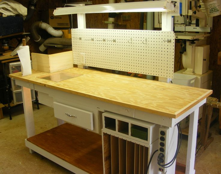 A stain glass work table for my daughter. It features an overhead light plus a light box for the patterns.I added storage for the glass under the bench.