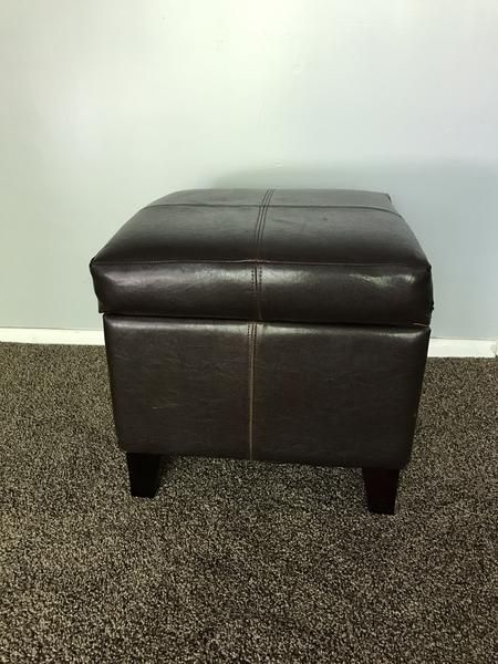 Small storage ottoman. Looks nice from the front. The lid used to stay open by itself, this is an easy fix.