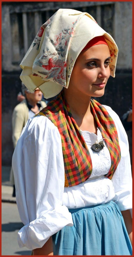 Europe   Portrait of a young woman wearing traditional clothes and headscarf, Cavalcata maggio 201, Italy