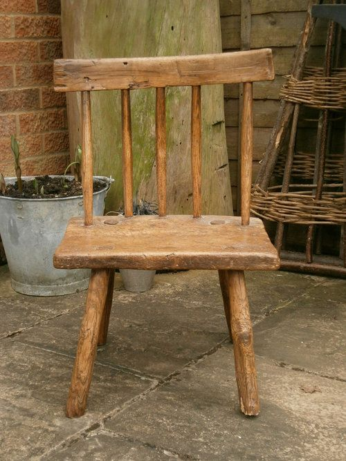 Late 18th early 19th century    primitive ash and elm stick chair    the stick back over solid elm seat    the surface is good    the legs are staked
