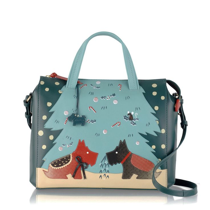 The Under the Mistletoe leather zip-top grab is our fabulously festive Picture Bag for AW15. Radley is proud to support emerging talent. This unique piece was designed by illustrator Rachael Saunders, a recent graduate with an amazing sense of colour, texture and playfulness.