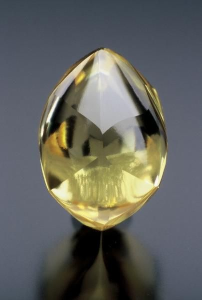 Diamond- (Okie Dokie diamond) (4.21 -carats, rare canary-yellow color for locality), Crater of Diamonds State Park, Pike Co., AR, ~1.5 cm.