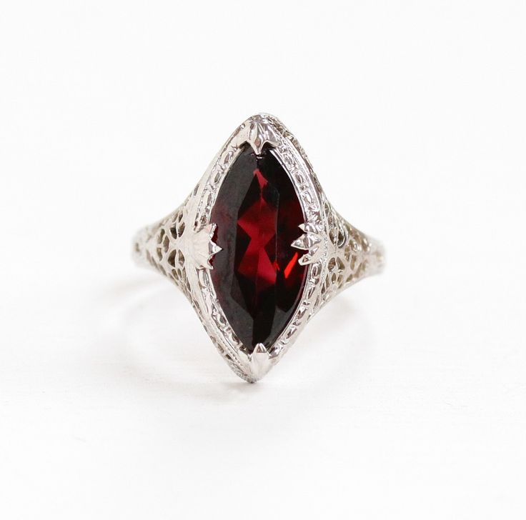 Vintage Art Deco 14k White Gold Filigree Garnet Ring - Antique 1920s Size 6 1/2 Red Maroon Marquise Navette Gemstone Statement Fine Jewelry by MaejeanVintage on Etsy https://www.etsy.com/listing/236222542/vintage-art-deco-14k-white-gold-filigree This ring is nice, wish there wasn't a halo around the stone.
