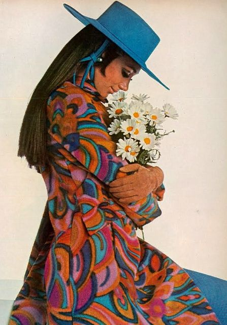 Model Marisa Berenson photographed by Penati wearing a coat by Bill Blass for Maurice Rentner and hat by Halston. Vogue,August 1967.
