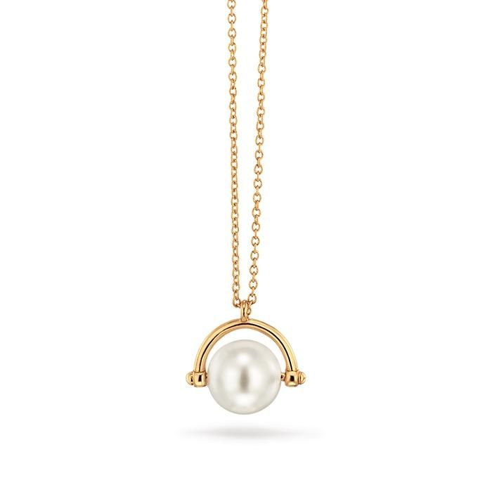 "Modern yet minimalist. Goldtone with simple faux-pearl pendant, 34"" L with 3 1/2"" extender."