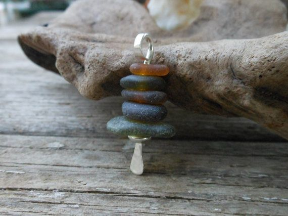 Handmade sea glass jewelry. Stone cairns are often used to mark hiking trails in areas where there are no trees. It is tradition for each person that passes by to add another stone to the top of the cairn to counteract the effects of winter weather. I use my cairn pendant as a