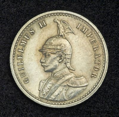 German East Africa Quarter Rupee (1/4 Rupie) Silver Coin of 1898. Obverse: German Emperor Wilhelm II in military uniform, wearing a helmet with the Germanic eagle perched on top.  German East Africa coins Silver Quarter Rupee - German East Africa Coins - German East Africa silver coins - German East Africa numismatic - Coins of German East Africa - Numismatic Collector Coins - buying silver coins for investment.