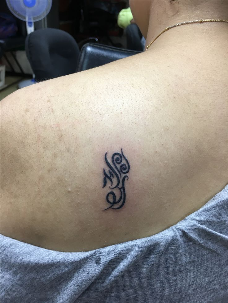 Different symbols of significance coming together in one tattoo (The first alphabets of my husband and sons names in Devnagri and Hebrew scripts,my zodiac sign and the number 9)
