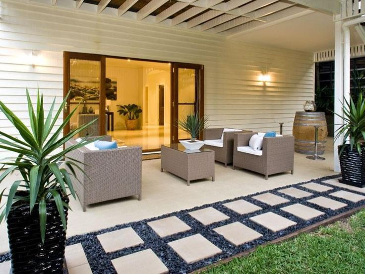 Indoor-outdoor outdoor living design with verandah & decorative lighting using grass - Outdoor Living Photo 424021