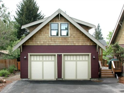 Detached garage with upstairs living/storage space.