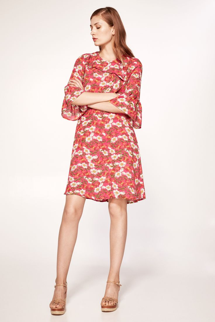 Tunic dress with floral print. Three-quarter-length sleeves with ruffles and round neck.   Dresses and jumpsuits   Cortefiel Man & Woman