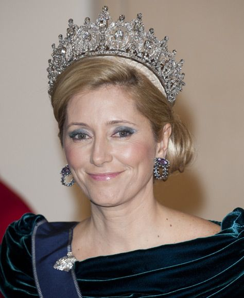 Let's Hope She Ruptures a Disc in Her Neck: Crown Princess Marie Chantal, almost outweighed, sports one of the most famous tiaras in Europe. This piece of the Greek Crown Jewels hadn't been seen in decades. Not bad for a royal family that doesn't exist. (Makes one wonder how she can be a crowned princess...how can one be next in line to an abolished throne?