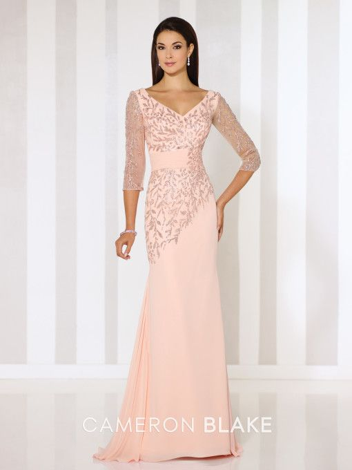 Cameron Blake - 116651 - Chiffon sheath with glitter printed illusion three-quarter length sleeves, front and back V-necklines, glitter printed bodice with asymmetrically dropped waist and ruched midriff, sweep train.  Sizes: 4 – 20, 16W – 26W  Colors: Oyster Pink, Jade, Navy Blue