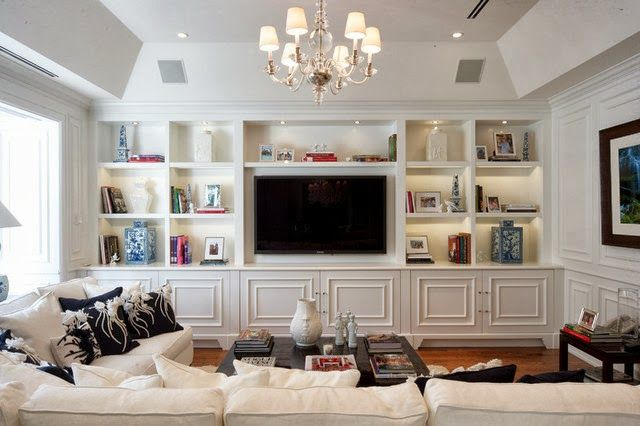 A Blue and White Miami Manse- The Glam Pad (wall of built-ins with large cubbies and big flat-screen TV)