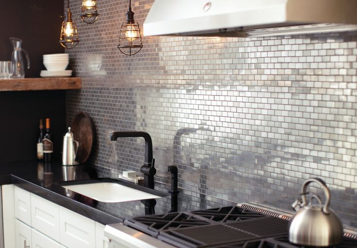 Vintage industrial. Add shine and sophistication with an urban edge to your kitchen. Incorporate this style with bold details, like metal mosaic tile and cage pendant lighting. Get the look.