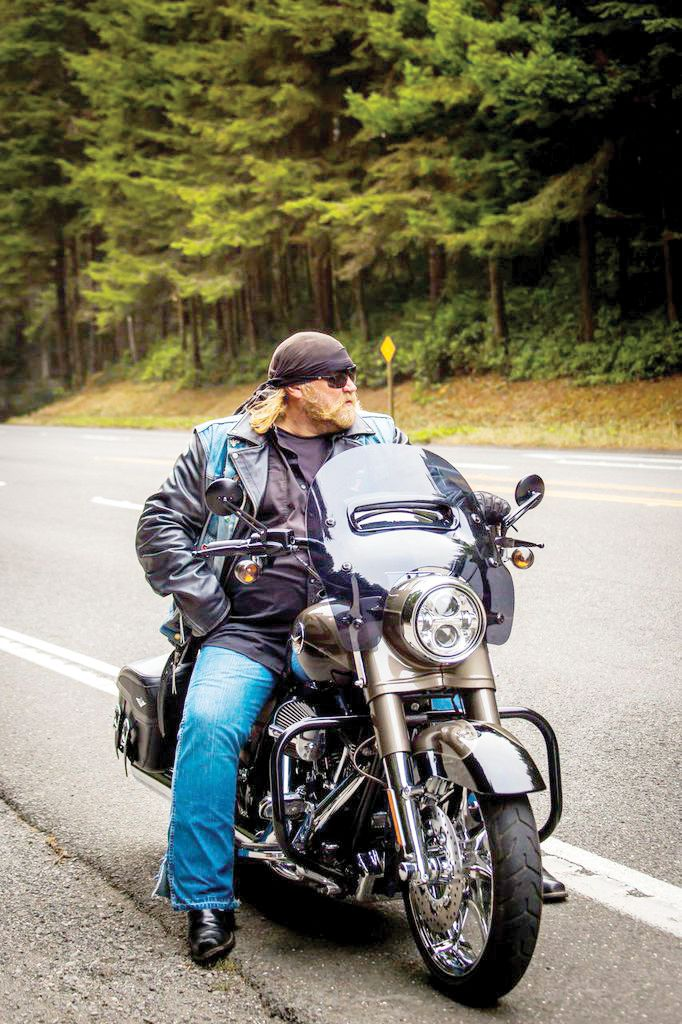 "american ride"" host and star stan ellsworth on his harley-davidson"
