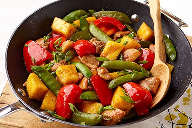 This 25-minute chicken thighs stir-fry gets its sweet and colorful appeal from red peppers, chunky pineapples and sugar snap peas.