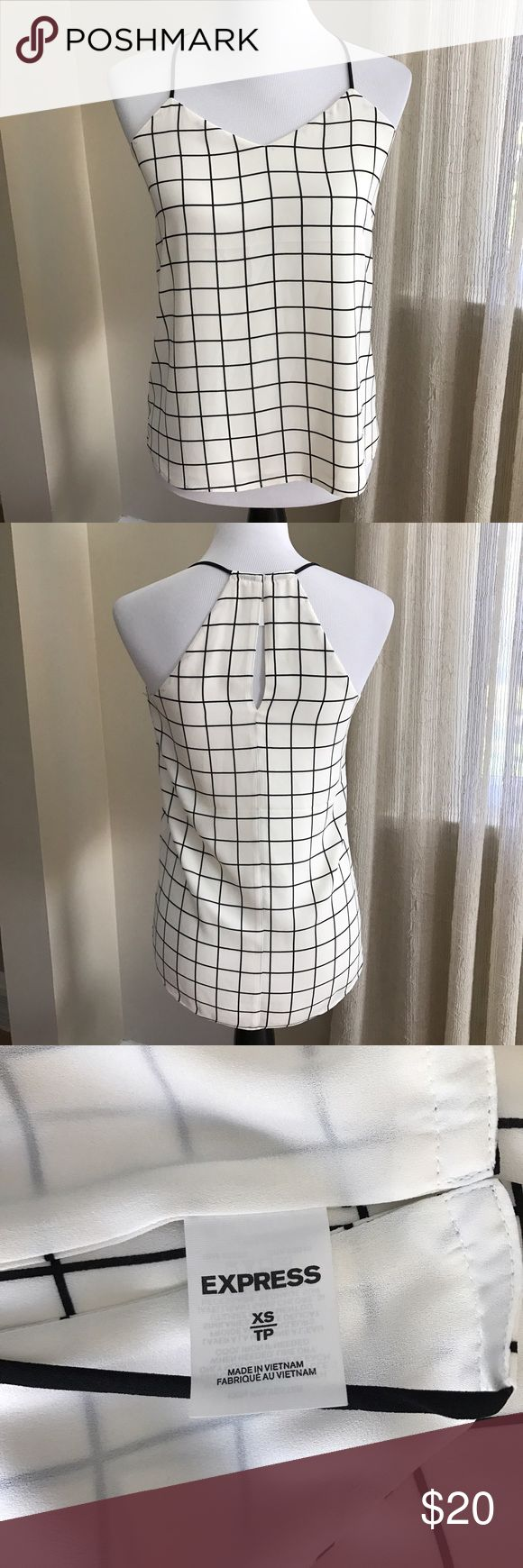 """Express Sleeveless Blouse Black and White XS Express Sleeveless Blouse Black and White XS. Fully lined. Arm pit to arm pit: 17"""". Under arm to hem: 18"""". 100% polyester. Express Tops Blouses"""