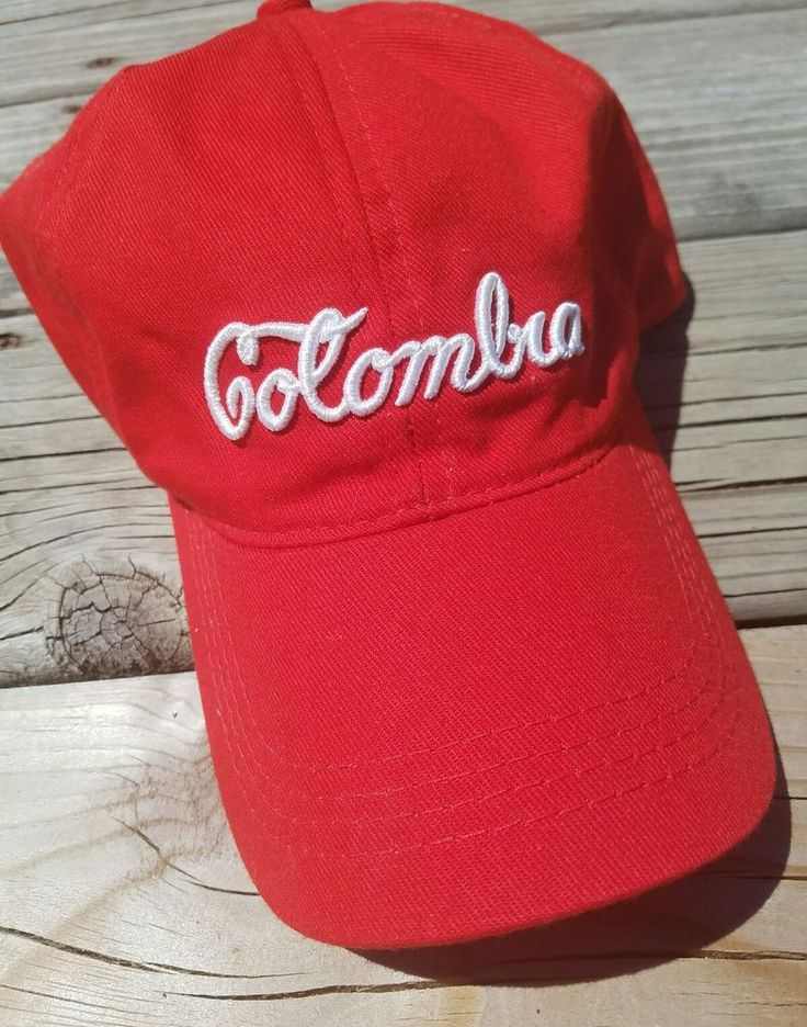 """Columbia Hat     Tourist Hat from Columbia the country. Red hat with white cursive writing that says """"Columbia"""" Back has adjustable metal size band.    America del Sur Brand     Great, pre-owned condition. No signs of wear - no pilling, unraveling stitching, stains or markings. See images for more details and condition specifics.     Measurement (approximately)  Circumphrerence of Hat (At Max Size) - 21""""    Payment due via Paypal within 2 days of end of auction.    Be sure to c..."""