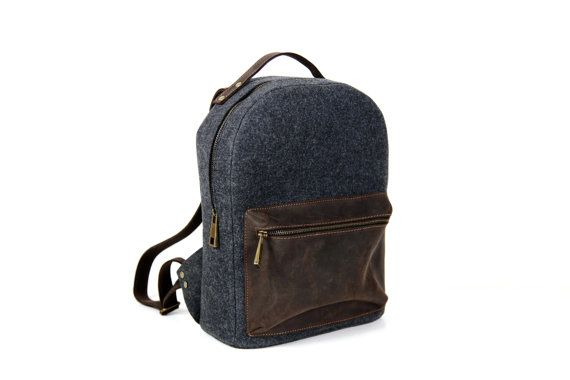Backpack made of split leather and felt.  Closes on the zip.  It has got regulated straps.  Size: 36cm x 28cm x 18cm    All products are handmade in our manufacture in Poland  Best material and quality.