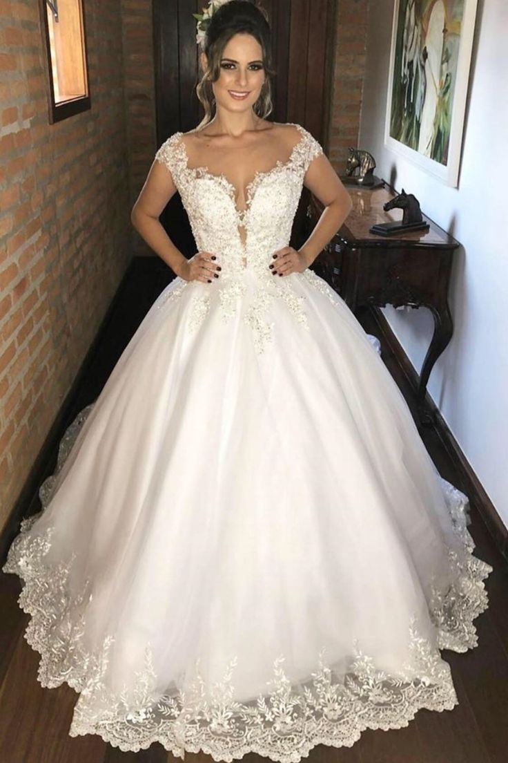 Lace cap sleeves ivory bridal gown with illusion neckline