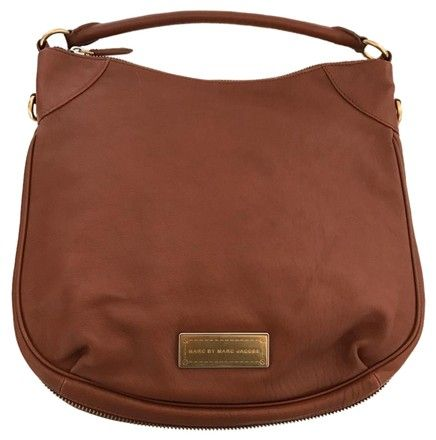 Marc by Marc Jacobs Brown Leather Hillier Hobo Bag. Hobo bags are hot this season! The Marc by Marc Jacobs Brown Leather Hillier Hobo Bag is a top 10 member favorite on Tradesy. Get yours before they're sold out!