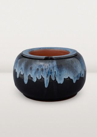 This Blue Waters planter comes from the mountain kingdom and is made with a self-watering insert. Includes instructions for use.