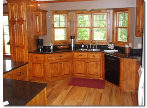 Luxury Knotty Pine Cabinets with Granite Countertops
