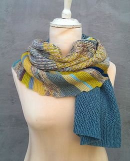 Fun and colorful shawl that sports garter stripes, brioche stitch and beautiful lace.