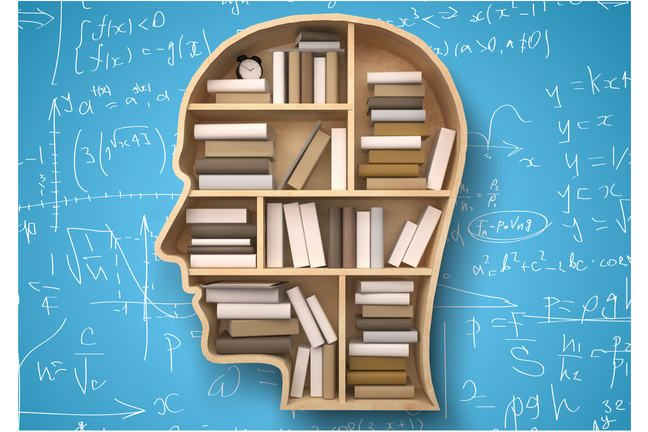 Wooden human head filled with books on blue background with scrawled mathematical symbols