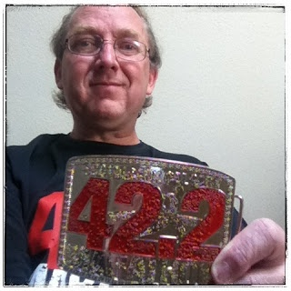 Calgary Marathon finisher belt buckle medal.