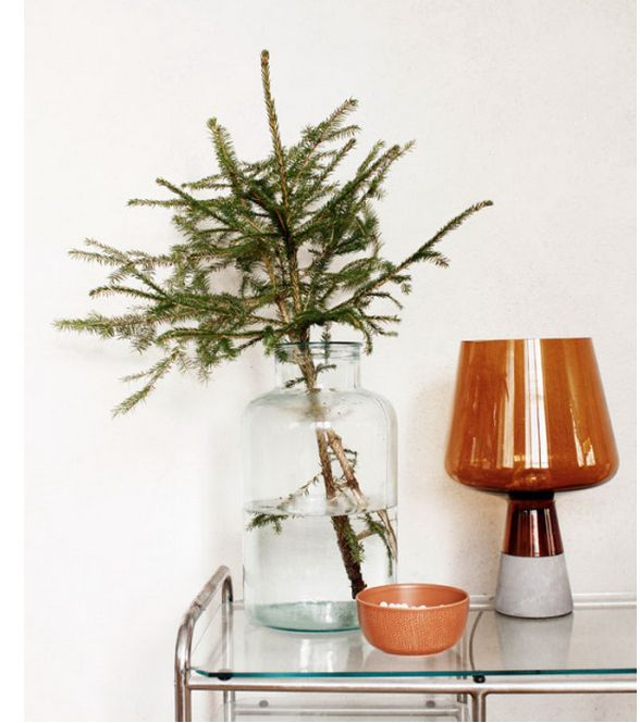 Cut branches from your Christmas tree to make easy table decor.   38 Clever Christmas Hacks That Will Make Your Life Easier