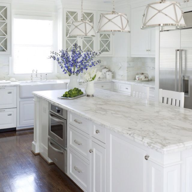 Carrara marble counter, white cabinets , dark floor look for master bath