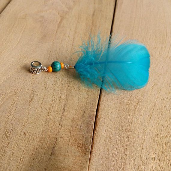 Check out this item in my Etsy shop https://www.etsy.com/listing/550252619/feather-dread-bead-hair-jewelry