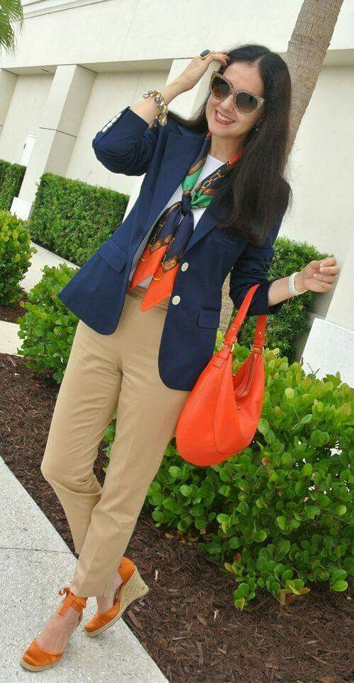 Navy sweater, tan slacks, orange shoes and purse. Scarf to pull it all together.