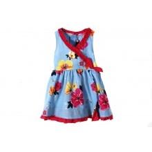 Vestido de Catimini Vestido color azul cielo primaveral con flores rojas y amarillas, y con un borde bordado rojo.