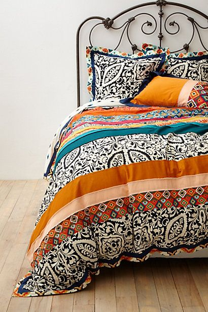 Florence Bedding #anthropologie :: A little busy but I love the colors/patterns especially with this bed frame. (Though not the bed frame in itself.) Gray walls and light wooden furniture. (OR nice for a shower curtain/bathroom theme).