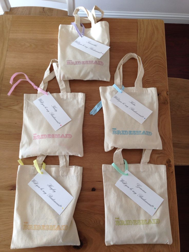 I gave these filled with goodies to my bridesmaids when I asked them to be bridesmaids!! Tote bags were bought from Ebay where I chose colour and text. I am having different pastel colours as the dress colours so the text, ribbon and Rimmel nail polish inside indicate what colour everyone is!!