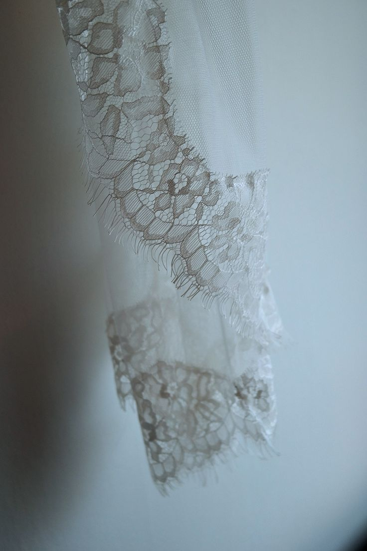 Theia is pure as the fairest light and light as the most airy candy floss. She is the perfect example of a classic veil where it is the details the makes the characterer. She is made of soft english net with a delicate chantilly style lace attached along the edges. The lace is traditionally tea-dyed. Theia is a classic fingertip length standard cut veil, wich gives you the opportunity to wear her in many different ways.