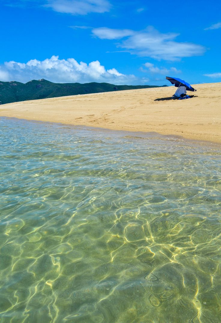 Langford Island, Whitsundays, Great Barrier Reef, Australia - A tiny, uninhabited island near the Hayman Island Resort. Resort staff will drop you off with just a chair and an umbrella (and a radio for emergencies) and you can spend the whole afternoon on your own private island.