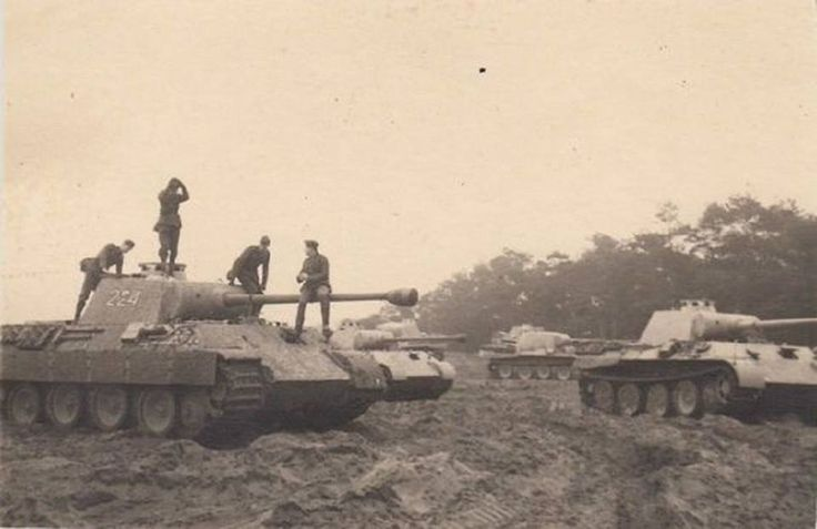 Six Panthers sitting outside Magdeburg, Germany 1944.