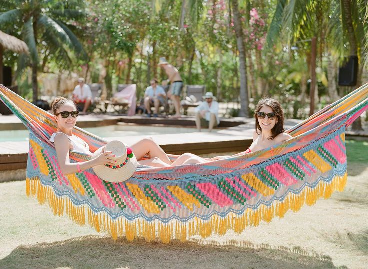 Beautiful besties lounging on the colorful Colombian hammocks found throughout the property.