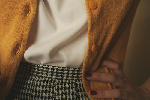 mustard cardigan, cream blouse and houndstooth skirt. <3
