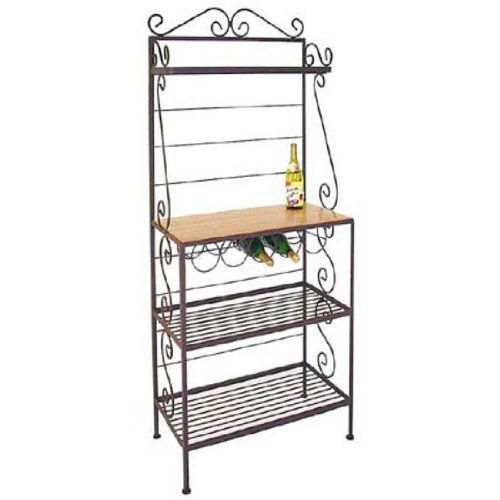 "30"" Wrought Iron Gourmet Bakers Rack Metal Finish: Jade Patina, Option: With Brass Tips by Grace Collection. $565.22. 30GO B (JP) Metal Finish: Jade Patina, Option: With Brass Tips Features: -Ships fully assembled.-Choose ''With Brass Tips'' or ''Without Brass Tips''.-Wire shelves only - no glass.-Shelf Depths - 9'', 15'', 15'', 15''.-Artistically crafted in wrought iron. Options: -Available in 12 designer metal finishes. Color/Finish: -Painted according to your choice o..."